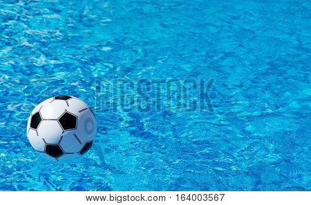 Beach Ball Floating In Blue Swimming Pool. Space For Text.