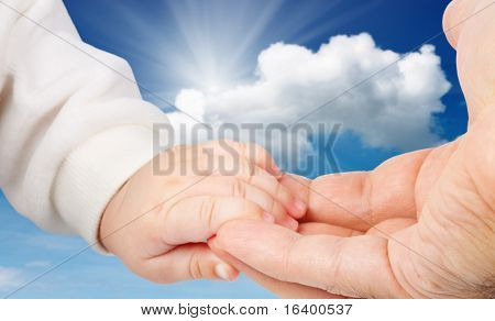 Baby holding father's hand