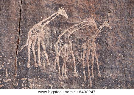 Roca antiguo grabado en el desierto del Sahara, Tadrart, Argelia