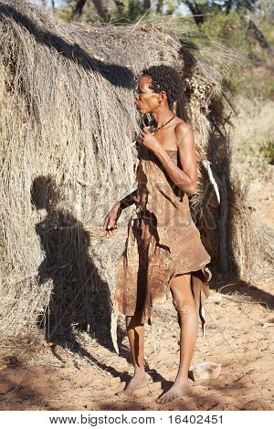 NAMIBIA - MAY 06: Bushman woman near hut on May 6, 2007 in Namibia, Kalahari Desert. Bushmen are an indigenous people of southern Africa that living in Namibia, Botswana and some another countries