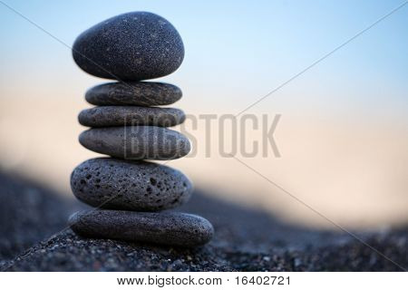 Balanced Stones. Stack of volcanic pebbles on seashore