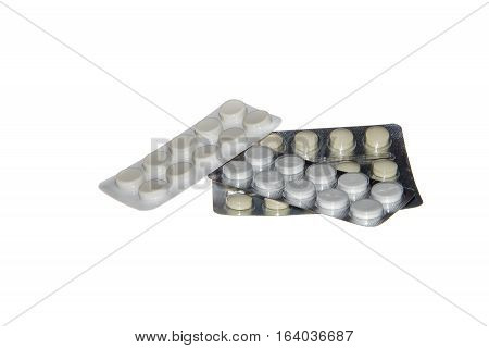 Blister packs of pills isolated on the white background three package of pills. Close