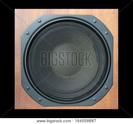 Subwoofer Loud speaker system with round black grill and wooden finish isolated on black closeup