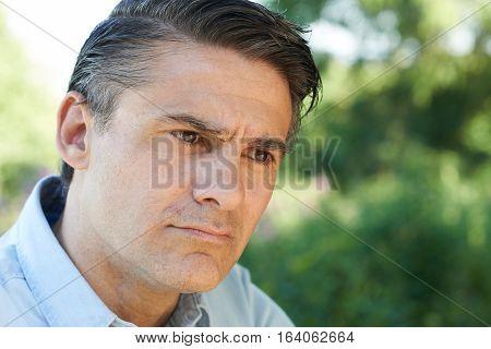 Head And Shoulders Portrait Of Concerned Mature Man
