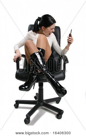 Young rage shout businesswoman on cell phone isolated on white. In all growth. In the studio