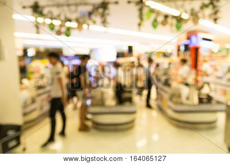 People Make Payment At Cashier Counter In Supermarket