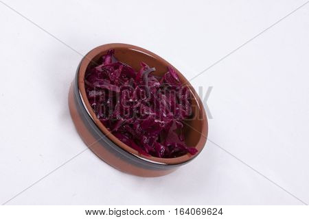 photo of pot of red coleslaw isolated on a white background