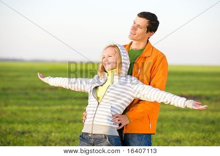 Happy smiling couple fly in sky