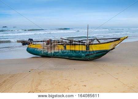 Fishing boat on the sand beach. Indian ocean. Sri Lanka.