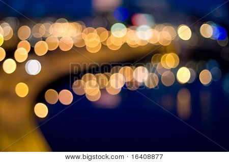 City lights by water out of focus