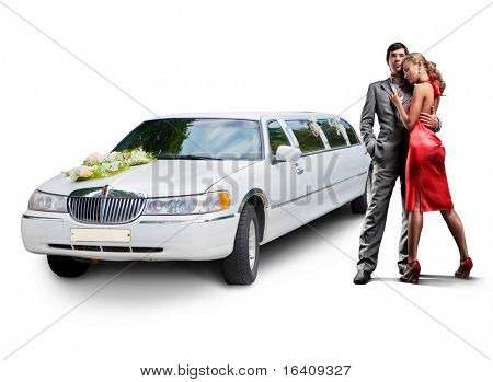 Young beautiful couple with their wedding limousine