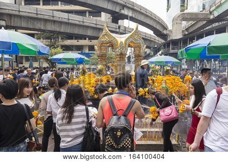 BANGKOKTHAILAND - DEC 31 : scene of tourist worship in Erawan shrine in ratchaprasong area while new year festival on december 31 2016 Thailand. Erawan shrine is famous place for tourist