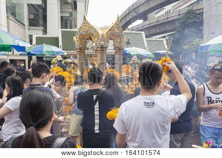 BANGKOKTHAILAND - DEC 31 : snapshot of tourist worship at Erawan shrine in ratchaprasong area on december 31 2016 Thailand. there are many tourist worship at Erawan shrine in new year festival