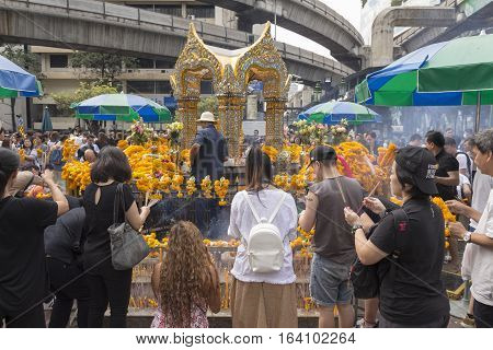 BANGKOK THAILAND - DEC 31 : Unidentified tourist worship at Erawan shrine in ratchaprasong area on december 31 2016 Thailand. there are many tourist worship at Erawan shrine in new year festival