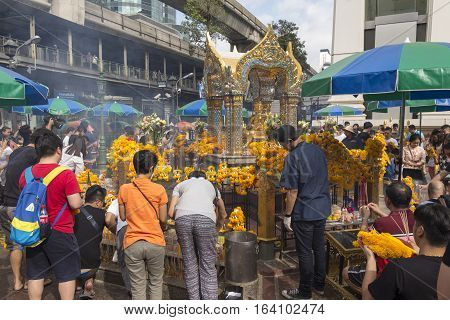 BANGKOK THAILAND - DEC 31 : crowd worship in Erawan shrine in ratchaprasong area on december 31 2016 Thailand. there are many tourist worship at Erawan shrine in new year festival