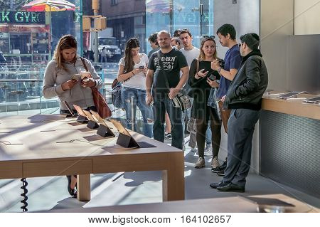 New York October 5 2016: People stand in line in the Apple store on Manhattan's Upper West Side waiting to purchase a new iPhone.