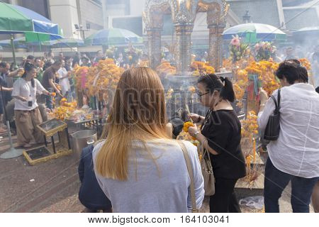 BANGKOKTHAILAND - DEC 31 : Unidentified person worship in Erawan shrine at ratchaprasong area on december 31 2016 Thailand. there are many tourist worship at Erawan shrine in new year festival