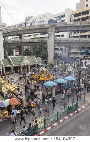 BANGKOKTHAILAND - DEC 31 : city scene of Erawan shrine at Ratchaprasong Junction while new year festival on december 31 2016 Thailand.