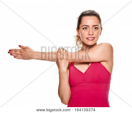 Attractive young woman stretching arm on white background