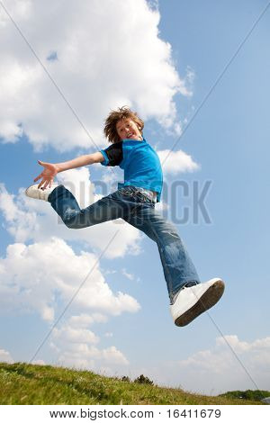 Happy jumping boy. Soft focus. Focus on eyes