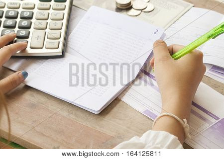 hand writing bill deposit passbook bank for financial expense and income