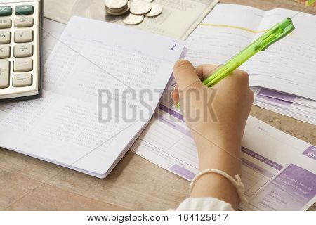 hand writing bill deposit with passbook bank for financial and income