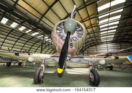 Madrid Spain - September 5 2015: Interior of an hangar with some rare vintage interceptor airplanes on September 5 2015 in Madrid air museum Spain.