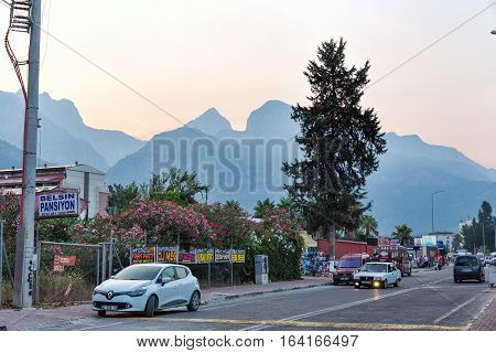 Kemer Turkey - June 28 2015: Early morning on the streets of the city of Kemer. Mountains in the rays of the sunrise. Turkey