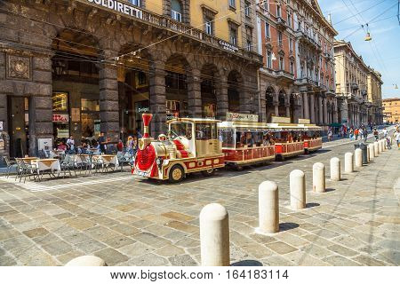 Bologna, Italy - May 28, 2016: tourist train in via Rizzoli, closed to traffic on Saturday, while taking tourists around the historic center of Bologna.