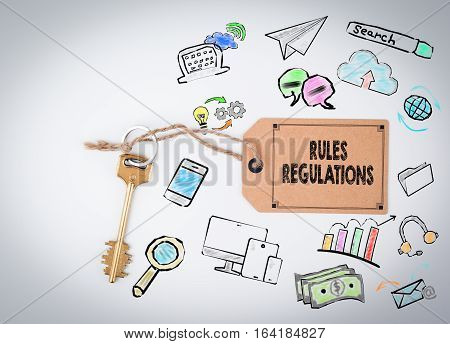 Rules And Regulations. Key and a note on a white background