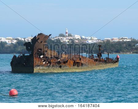 Rusting ship wreck in St Georges harbour Bermuda