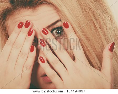 Woman Covering Face With Hands Showing Red Nails