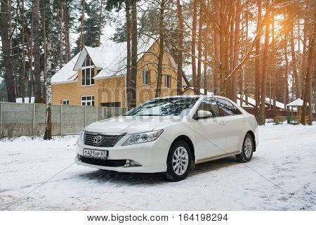 Smolensk, Russia - December 16, 2016: New luxury Toyota Camry parked in suburbia at winter evening.