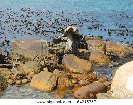 Huge Boulders In Fore Ground, With Sea In Back Ground 10aas