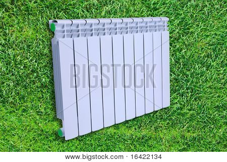 Radiator isolated over a background of green grass