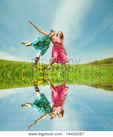 Mother and daughter with flower. Specular reflection in water.