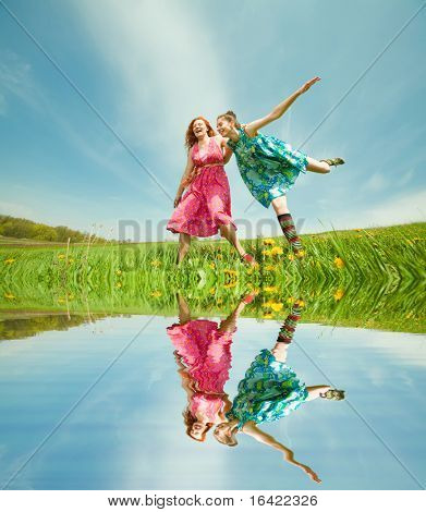Mother and daughter with flower. Specular reflection in water