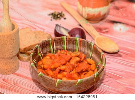 Romanian Traditional Food, Beans With Smoked Pork (fasole Cu Ciolan), Red Onion, Wooden Spoon, Salt
