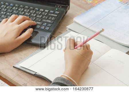 hand writing notebook monthly planner for financial on table