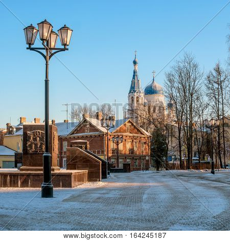 Gatchina, Russia - a view of the Pokrovsky Cathedral, left a fragment of the monument to the -City of Military Glory-, a wooden house is on the street Chkalov. Winter photos.