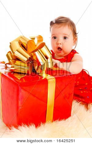 Baby girl in red dress received a large present