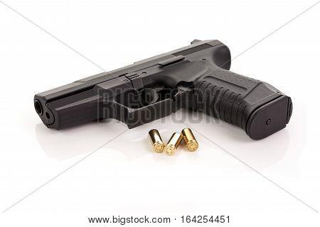 Handgun pistol with ammunition on white background