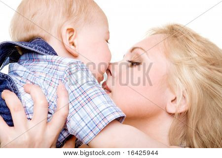 Closeup portrait of mom kissing baby son