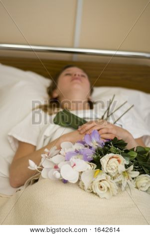 a dead young girl in the bed of the