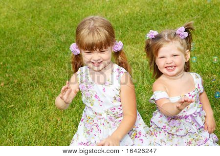 Happy kids popping bubbles