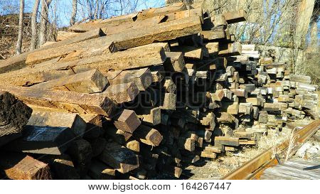 A good view of a pile of discarded railroad ties showing lots of  texture.