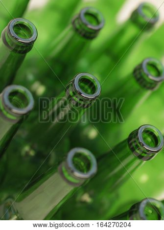 Green empty beer bottles ready for recycling or an art project.