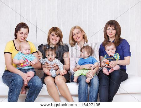 Four mothers with toddlers sitting on their knees