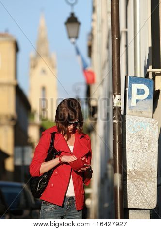 Young woman paying the parking fee