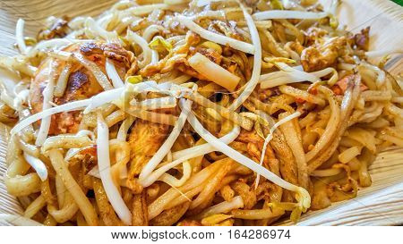 Fried rice noodles - asian street food style. A very popular dish in many asian countries.
